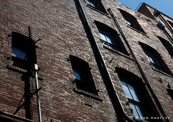 Upward view of historic old building in Seattle Washington. Shot taken in a back alley. © Rob Huntley