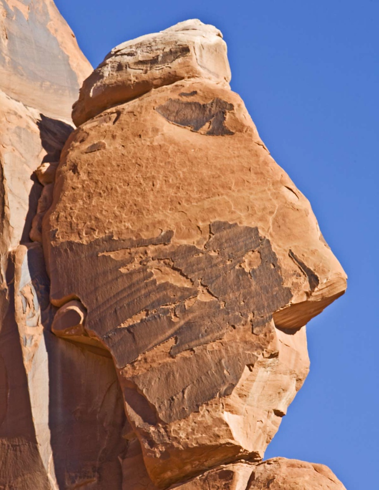 Arches National Park.  Rock looks as the face of a man with a bonnet.