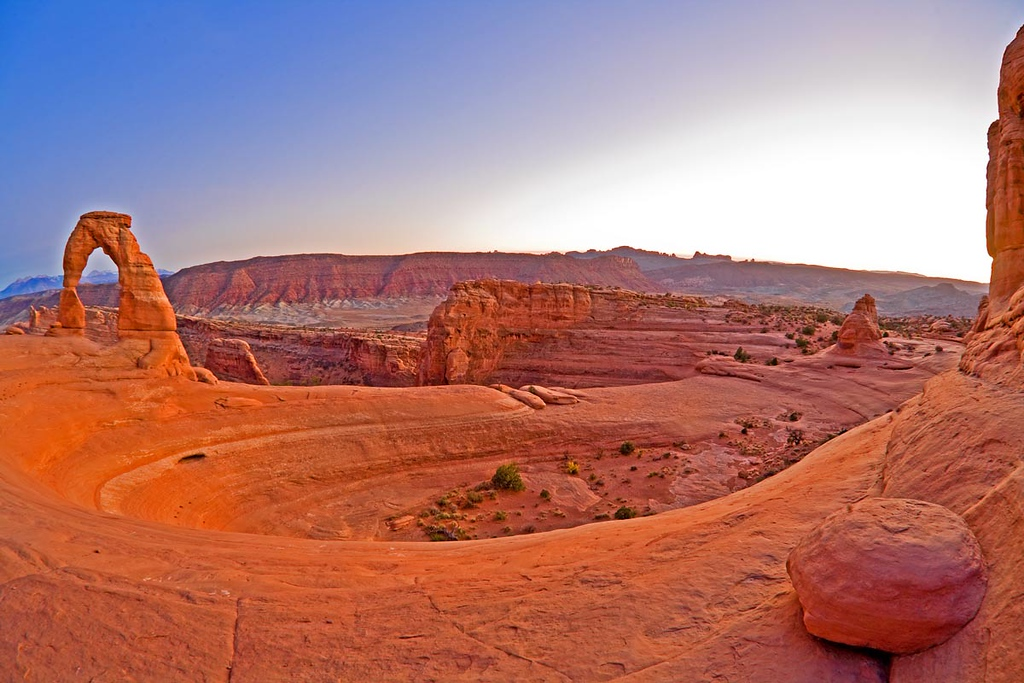 Delicate Arch at sunset taken with a fisheye lens.
