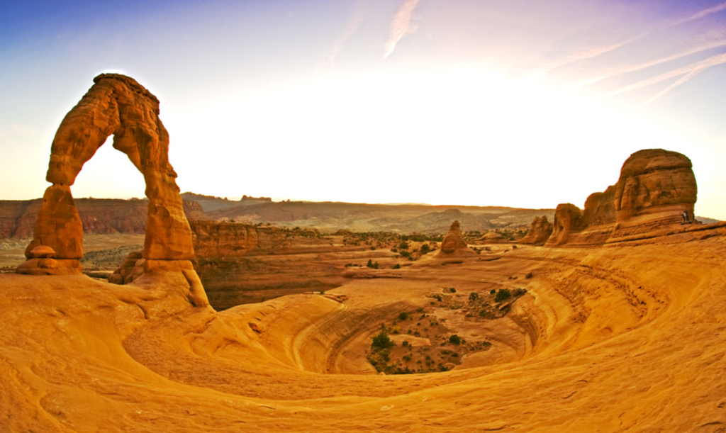 Delicate Arch at sunset.  Taken with fisheye lens; notice different color.