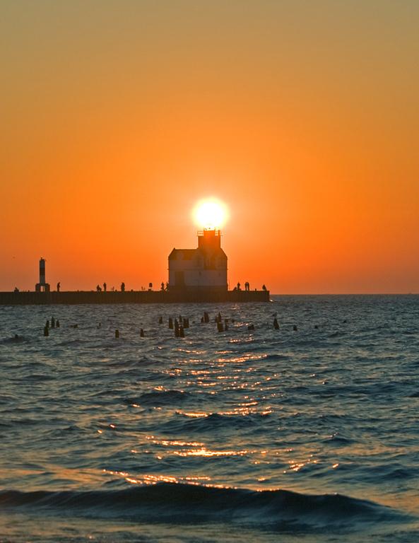 Sun rising over Kewaunee Lighthouse.