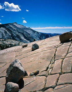 Rocks hanging precariously on a stone slope. Yosemite National Park.