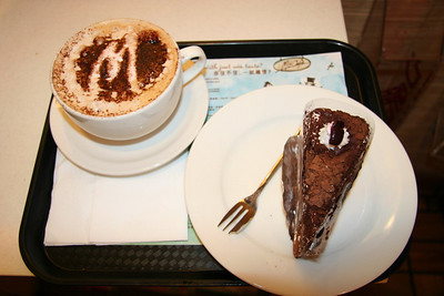 "My lunch from McCafe.  A large Moccachino and some Black Forest cake.  As advertised, the sugar was even added to look like an ""M"".  It was delicious too."