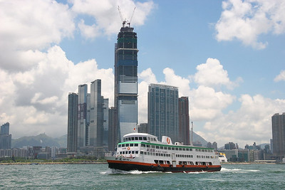 A ferry passing in front of the new section of Kowloon ... apparently trying to compete with Wan Chai across the bay.