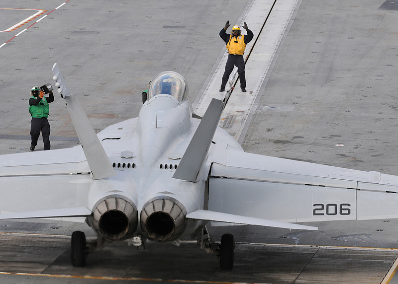 100203-N-3885H-005 - ATLANTIC OCEAN (Feb 3, 2010) -- USS GEORGE H.W. BUSH (CVN 77) flight deck personnel direct an F/A-18F Super Hornet from Strike Fighter Squadron (VFA) 213 on the ship's flight deck during flight operations Feb. 3.  Bush, the Navy's 10th and final Nimitz-class aircraft carrier, is currently underway in the Atlantic Ocean conducting Flight Deck Certification.  (U.S. Navy photo by Mass Communication Specialist 3rd Class Nicholas Hall)
