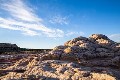 Sunrise over white sandstone in Southern Utah desert scene