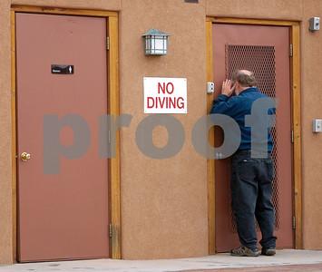 Mitch Trockman sneaks a peak into a utility room •  Moab, Utah • 2006