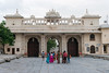 Entrance to Palace and city view from City Palace, Udaipur, Rajasthan, India.<br /> <br /> Gateways, colloquially called Pols, are set to the east of Udaipur city .A number of such gateways provide access to the palace complex. The main entry from the city is through the 'Bara Pol' (Great Gate), which leads to the first courtyard. Bara Pol (built in 1600) leads to the 'Tripolia Pol', a triple arched gate built in 1725, which provides the northern entry. The road between this gate and the palace is lined with shops and kiosks owned by craftsmen, book-binders, miniature painters and textile dealers.