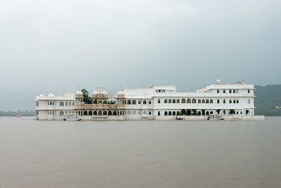 Taj Lake Palace on Lake Pichola, Udaipur, RJ, India Set in an 18th-century palace encompassing a Lake Pichola island, this luxury marble hotel, with original art, ornate details and glasswork, is a short boat ride from City Palace and was once featured in a James Bond film.