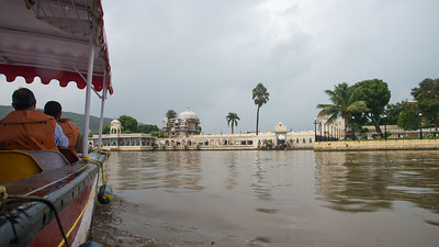 """Approaching Jag Mandir via boat on Lake Pichola.  Jag Mandir is a palace built on an island in the Lake Pichola. It is also called the """"Lake Garden Palace"""". The palace is located in Udaipur city in the Indian state of Rajasthan."""