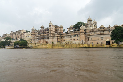 City Palace, Udaipur, Rajasthan, India as seen from Lake Pichola. A palace complex situated in the city of Udaipur, Rajasthan built over a period of nearly 400 years, with contributions from several rulers of the Mewar dynasty. Construction began in 1553, started by Maharana Udai Singh II of the Sisodia Rajput family as he shifted his capital from the erstwhile Chittor to the new found city of Udaipur. The palace is located on the east bank of Lake Pichola and has several palaces built within its complex.