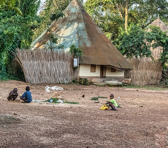 One of the wife's houses in the courtyard at Kasubi Tombs.  The descendants of the deceased kabaka's widows and their children live here.