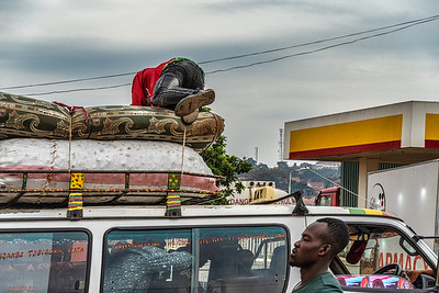 These 14 passenger van taxis are inexpensive and very popular in Uganda