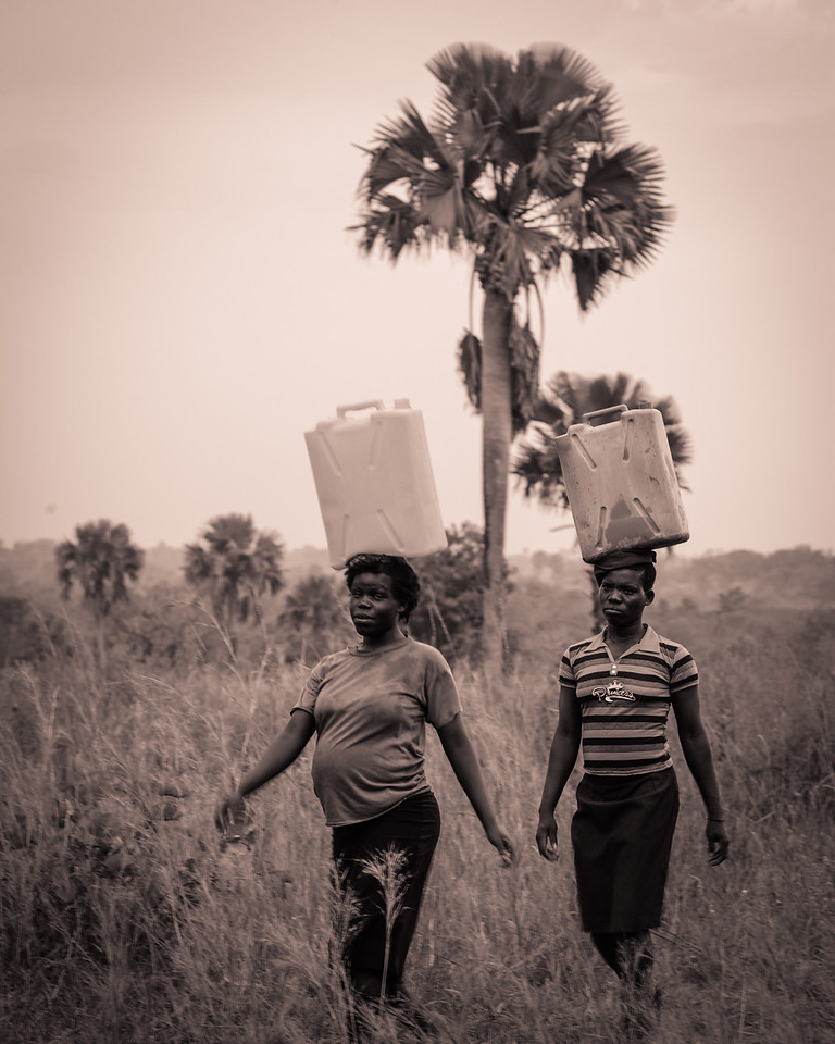Every evening each girl pumps water from the local well and carries it their hut on campus.