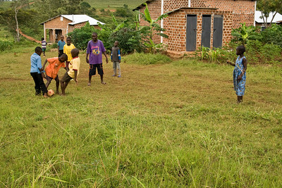 children playing football in the village
