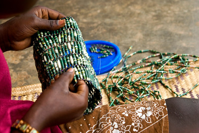 agnes working on a bead purse