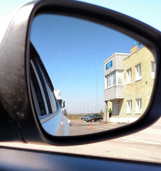 Ukraine-2017.  While driving from Kiev to the Missile Museum we get stopped at a routine police vehicle checkpoint.  My driver had to go in and show them his vehicle credentials.  I tried to take a picture of the police building via the side-view mirror while waiting in the car.