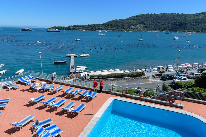 View from our room 309 of the Royal Sporting Hotel of Portovenere overlooking the Gulf of Poets.  Numerous fancy yachts moored in the bay during our stay.  The bouys in the foreground are where mussels are grown and harvested in early morning.