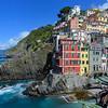 Riomaggiore village homes rise from the Mediterranean Sea atop the steep cliffs.