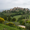 Gualdo Cattaneo - our first hill town on Sunday, May 15, 2016.<br /> We began our walk in rain.  The yellow bushes are a variety of broom plants (Scotch or Spanish).