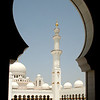 Sheikh Zayed Grand Mosque: view of minaret through main courtyard entrance portal.