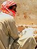 UAE - Dubai - Bastakiyya - worker in kaffiyeh