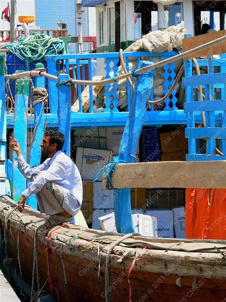 UAE - Dubai - Khor Dubai - boats for Iran and man