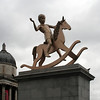 Trafalgar Square: Powerless Structures, Fig 101 - a gigantic bronze statue of a boy on a rocking horse, by Michael Elmgreen. Also visible are the dome of the National Portrait Gallery, and the spire of the church of St Martin in the Fields.