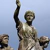 Brompton Cemetery monument: Faith, Hope and Charity against a leaden sky.