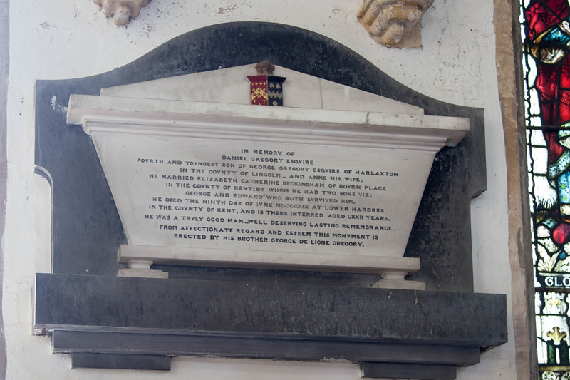 Plaque above the Gregory tomb marker.