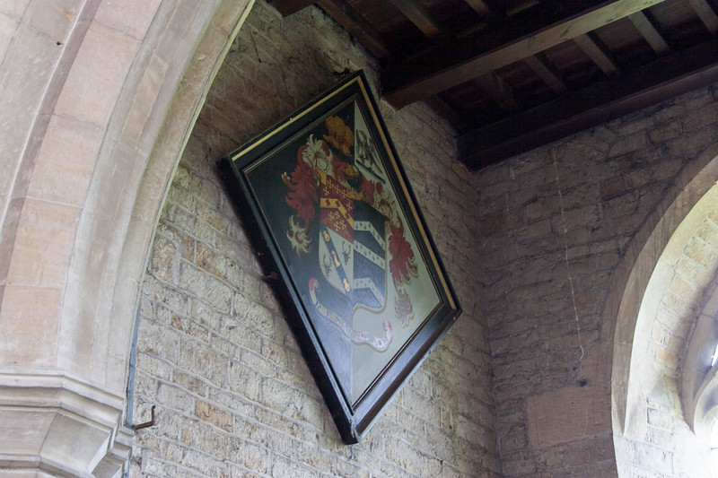 Coat of arms hanging in the rear of the sanctuary.