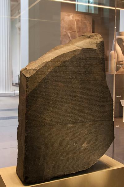 The Rosetta Stone displayed in the British Museum.