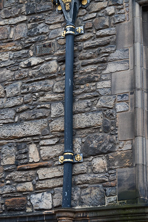 The royal insignia mark everything around the castle. Here you can see the Scottish thistle, English rose, and French fleur de lis adorning a rain gutter.