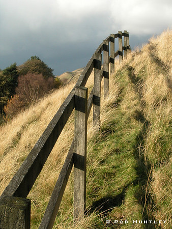 Fence disappearing over a Derbyshire hillside