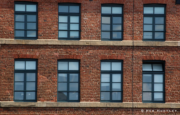 Windows and brick in an old industrial building near the Royal Armouries Museum in Leeds, UK. © Rob Huntley