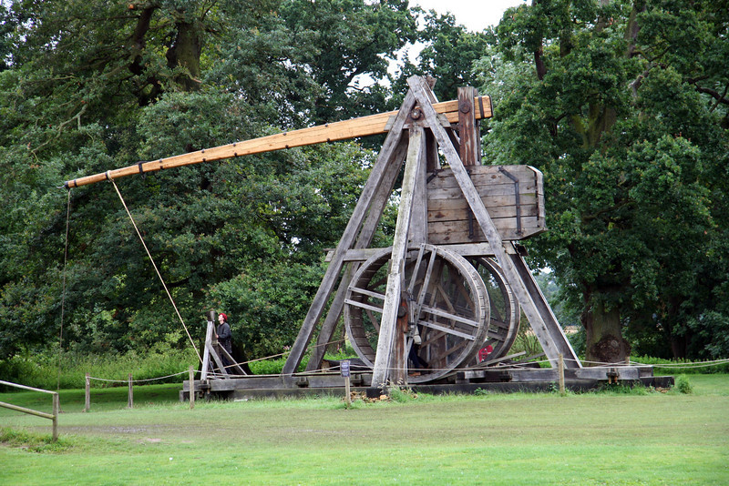 The giant trebuchet (catapult) getting ready to launch. Note the guys in the hamster wheels pulling it down.
