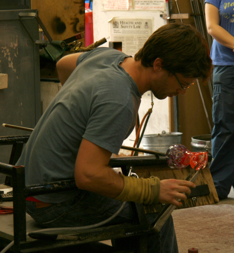 Here he is shaping the lip of this vase into a sort of lily.