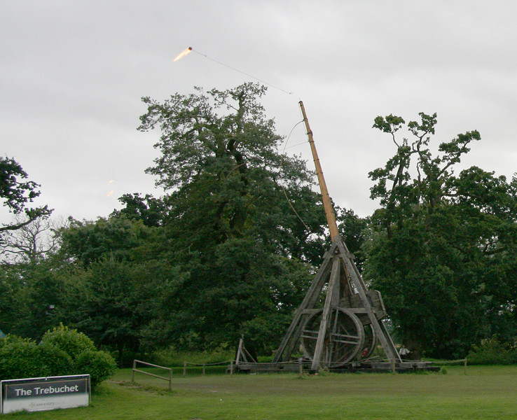 Trebuchet launches a fireball on a rope.