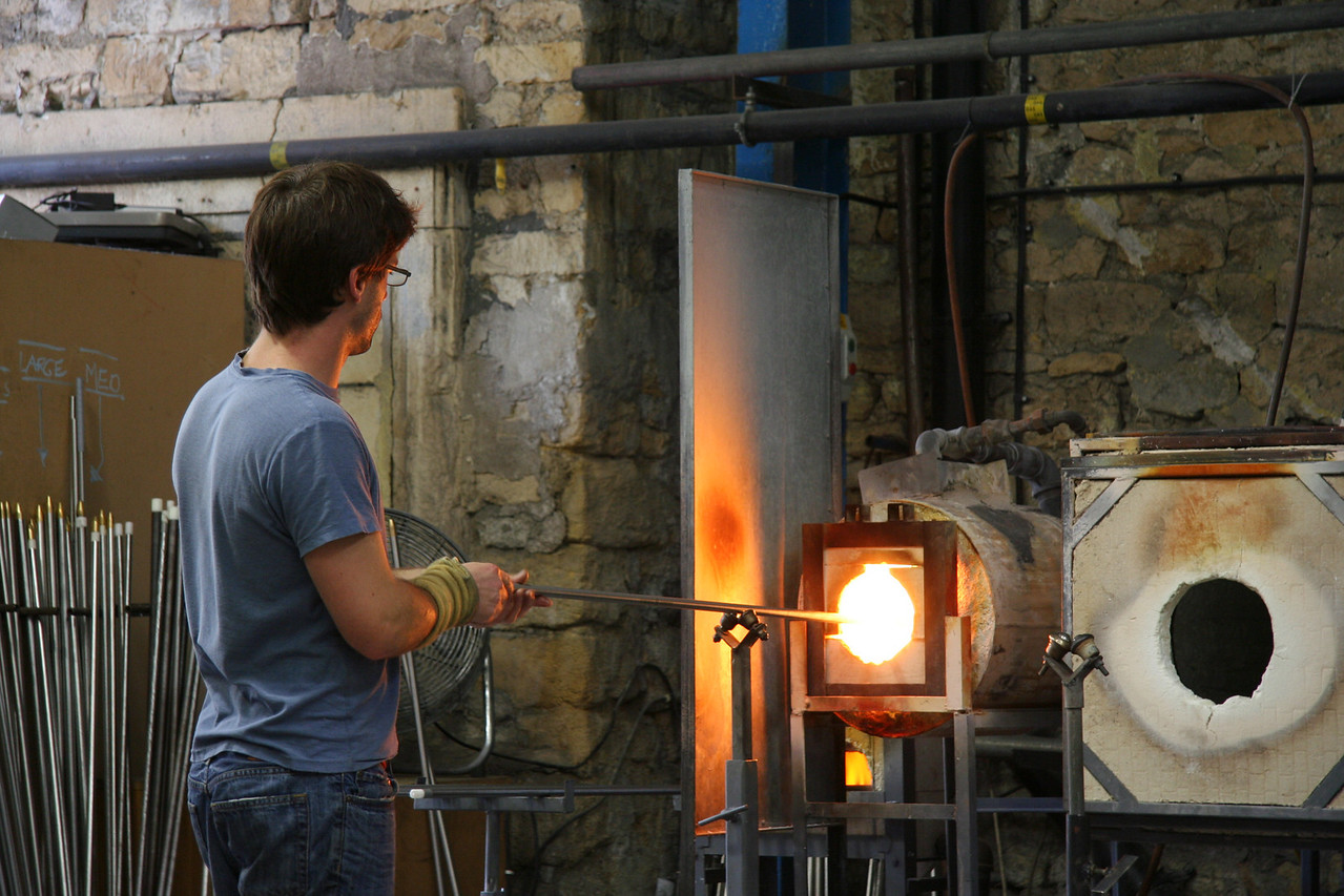 Glass blowing demonstration in Bath, England. Becoming a master glass blower can take a lifetime.