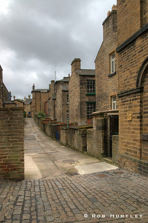 Back alley street scene in the town of Saltaire, England, near Leeds. HDR - high dynamic range image. © Rob Huntley Not for sale on this website but you may License this photo on Getty Images