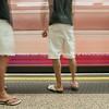 Commuters on platform.