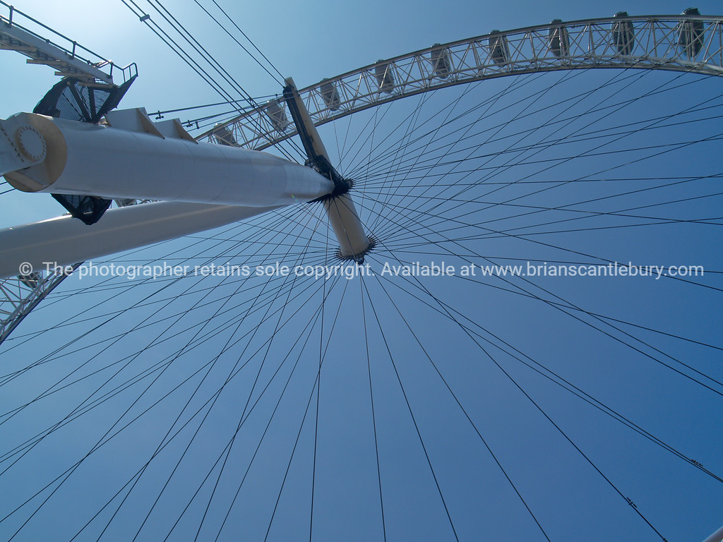 """Millenium Wheel, or London Eye ferris wheel, looking up through the spokes. A view of the UK SEE ALSO:   <a href=""""http://www.blurb.com/b/893070-impressions-of-the-uk"""">http://www.blurb.com/b/893070-impressions-of-the-uk</a>"""