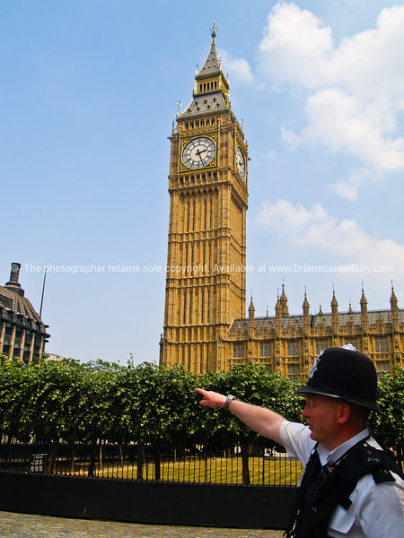 "Big Ben photograph, tower and clock, with bobby pointing the way, Westminster, A view of the UK<br /> Model released; no, for editorial & personal use. SEE ALSO:   <a href=""http://www.blurb.com/b/893070-impressions-of-the-uk"">http://www.blurb.com/b/893070-impressions-of-the-uk</a>"