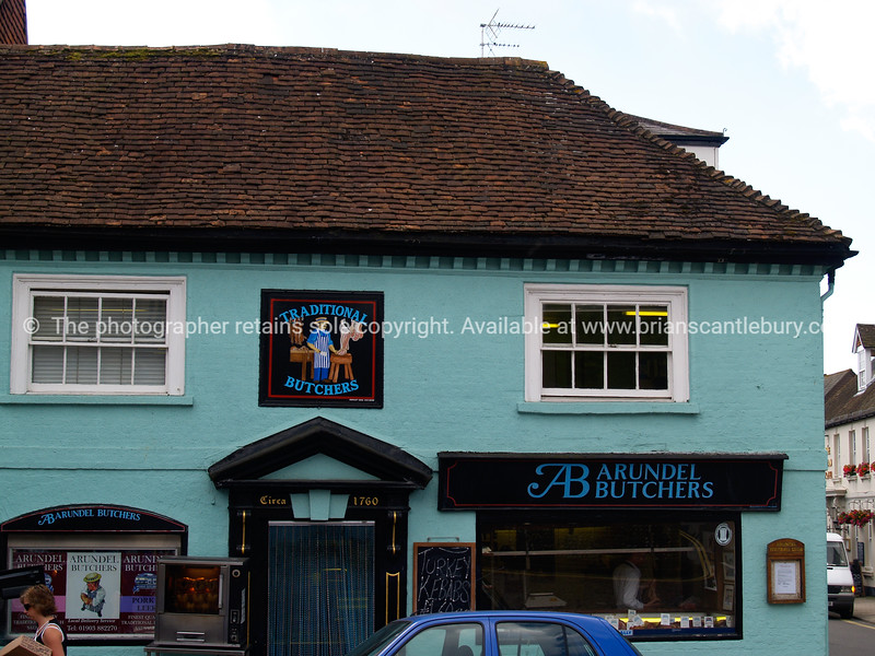 """Commercial building, Arundel,England. Butchers shop with sign above door """"circa 1776"""" SEE ALSO:   <a href=""""http://www.blurb.com/b/893070-impressions-of-the-uk"""">http://www.blurb.com/b/893070-impressions-of-the-uk</a>"""