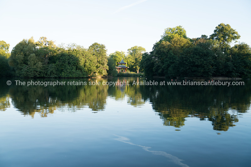 View across Victoria PArk lake at sunrise to Chinese Pagoda