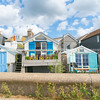Small holiday home line the waterfront at Whitstable.