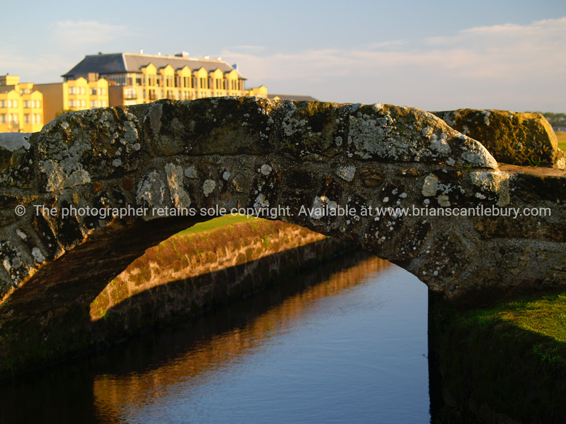 """Stone Bridge, St Andrews with Old Course Hotel in background. SEE ALSO:   <a href=""""http://www.blurb.com/b/893070-impressions-of-the-uk"""">http://www.blurb.com/b/893070-impressions-of-the-uk</a>"""