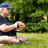 """Kite flying, man sits concentrating on holding his kite string reel.<br /> Model released; no, for editorial & personal use. SEE ALSO:   <a href=""""http://www.blurb.com/b/893070-impressions-of-the-uk"""">http://www.blurb.com/b/893070-impressions-of-the-uk</a>"""
