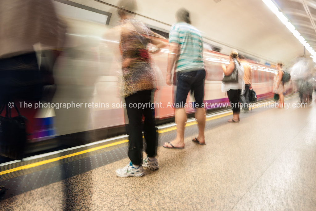 Commuters on platform of underground train station
