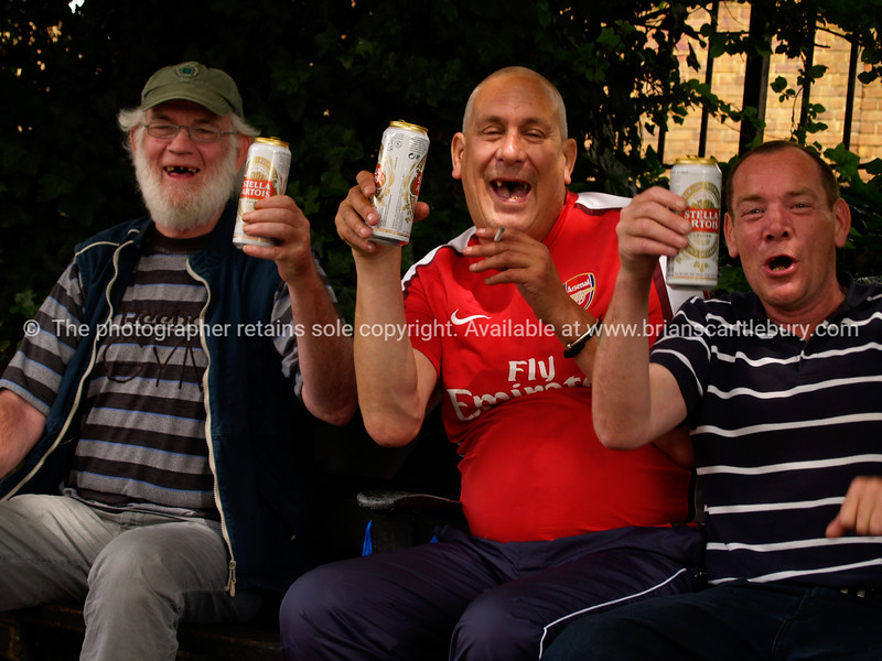 """Three happy men, drinking a beer and laughing, A view of the UK<br /> Model released; no, for editorial & personal use. SEE ALSO:   <a href=""""http://www.blurb.com/b/893070-impressions-of-the-uk"""">http://www.blurb.com/b/893070-impressions-of-the-uk</a>"""
